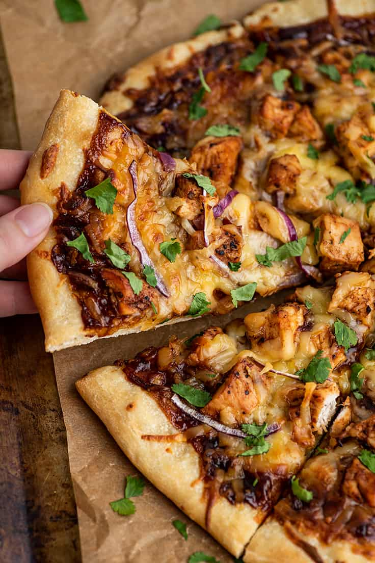 BBQ Chicken Pizza slice being picked up.