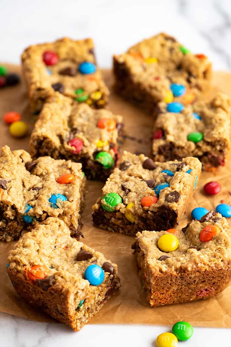 Small-batch monster cookie bars on parchment paper.