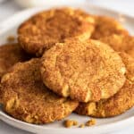Small-batch pumpkin snickerdoodles piled on a white plate.