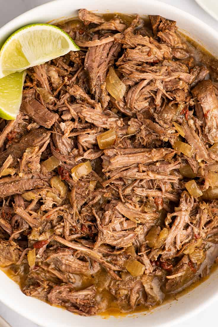 Barbacoa beef shredded for burritos in a bowl.