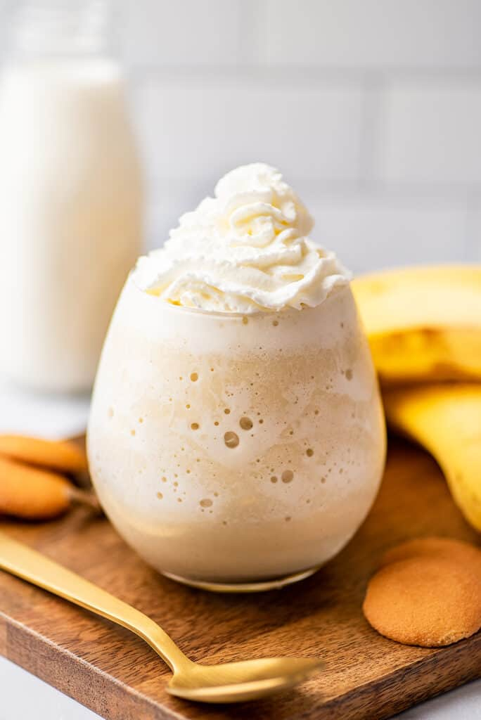 Banana milkshake without ice cream in a glass cup.