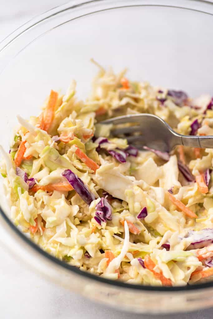 Coleslaw in a glass bowl.