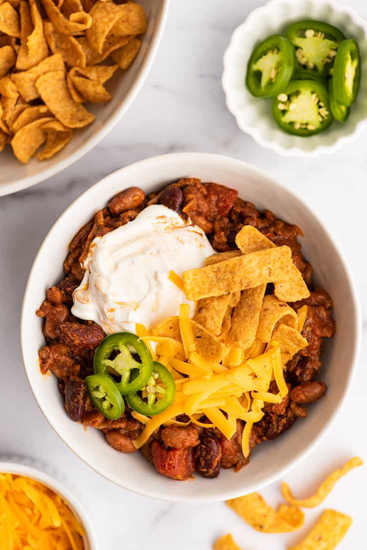 Easy chili recipe in a bowl with toppings.