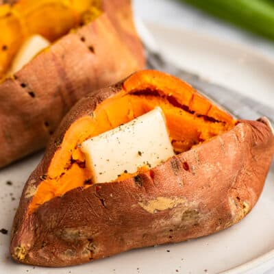 Microwave sweet potato cut open with butter and salt and pepper.