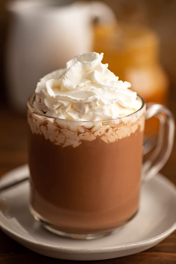 Salted caramel mocha in a glass mug with whipped cream.