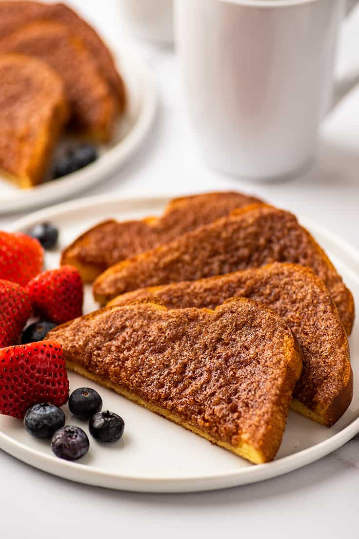 Cinnamon sugar toast on a plate with fruit.