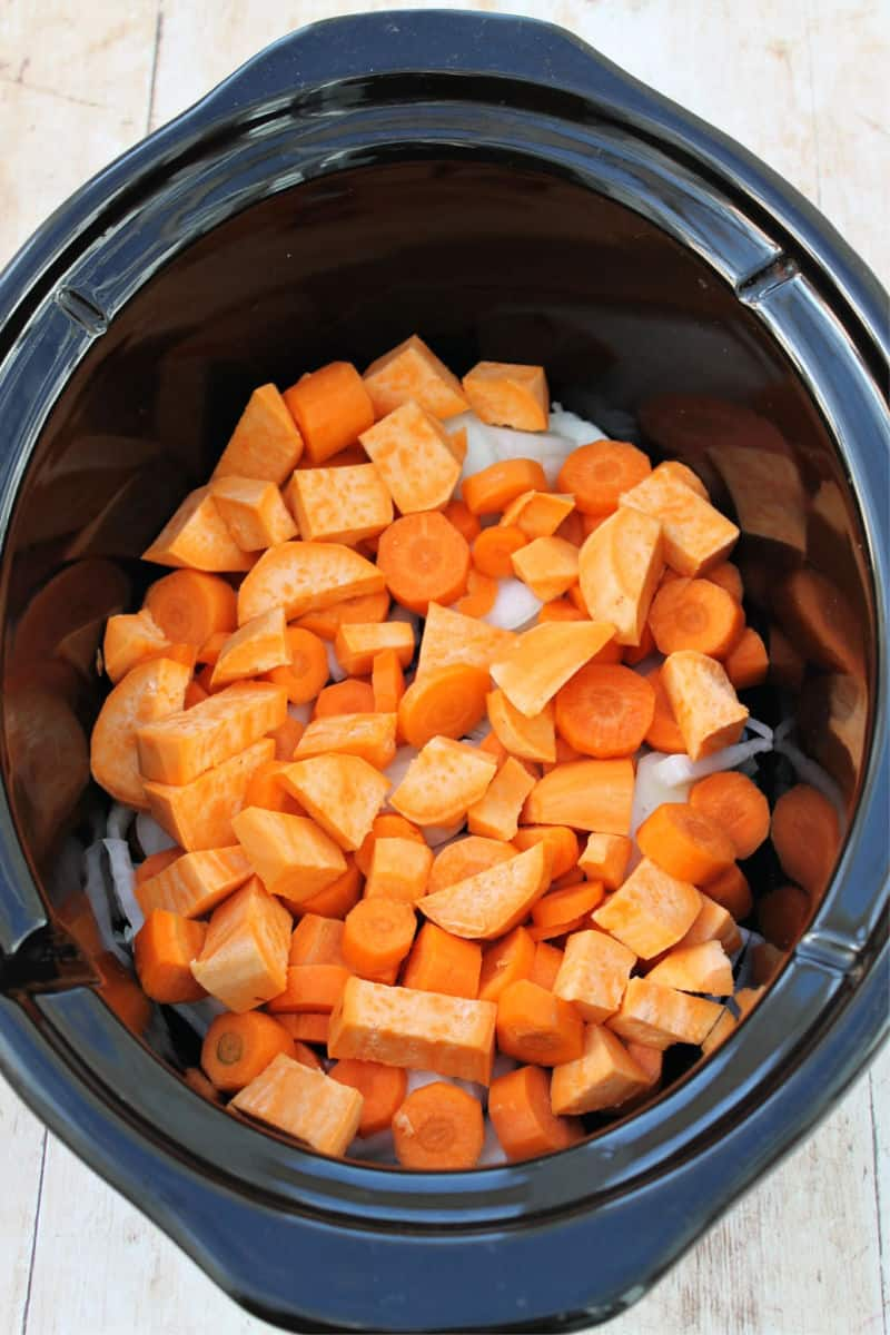 Slow cooker chicken casserole - sweet potatoes and vegetables in the base of the pot