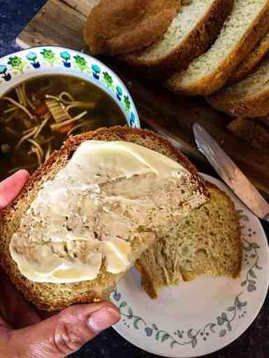 Vegan White Bread shown buttered