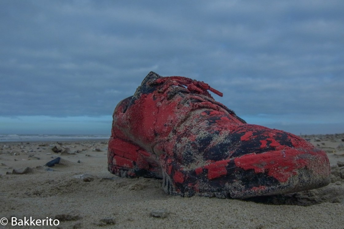 Red shoe on a beach