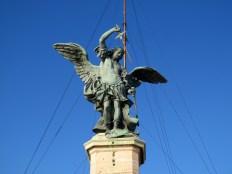 The archangel Michael sheathing his sword