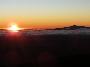 12.1419499510.sunset-with-maui-behind-the-clouds