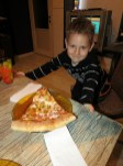 The little man and his big pizza slice