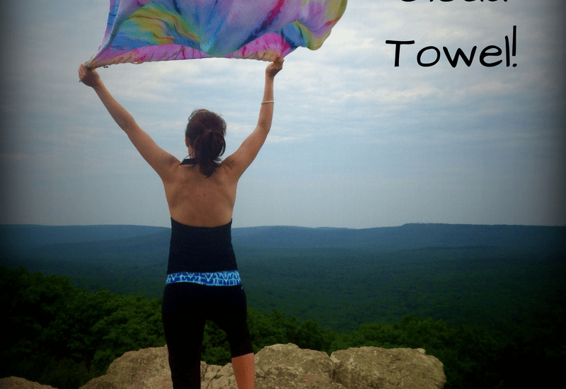 Lady on mountain with towel