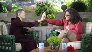 Pema Chodron is shown high-fiving Oprah Winfrey on Super Soul Sunday.