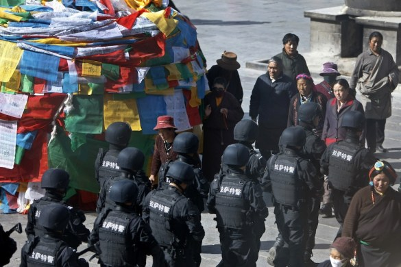 The Tibet China Conflict is at a critical spiritual juncture. Chinese riot please patrol Lhasa as Tibetan women look on in fear.