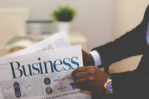 A man is shown holding a Business newspaper. Many individuals walk the wrong career path because they focus on things that should be of secondary importance.