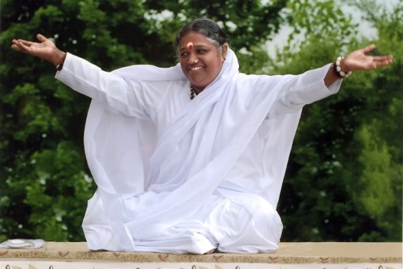 Amma, also known as The Hugging Saint, greets a crowd with open arms.