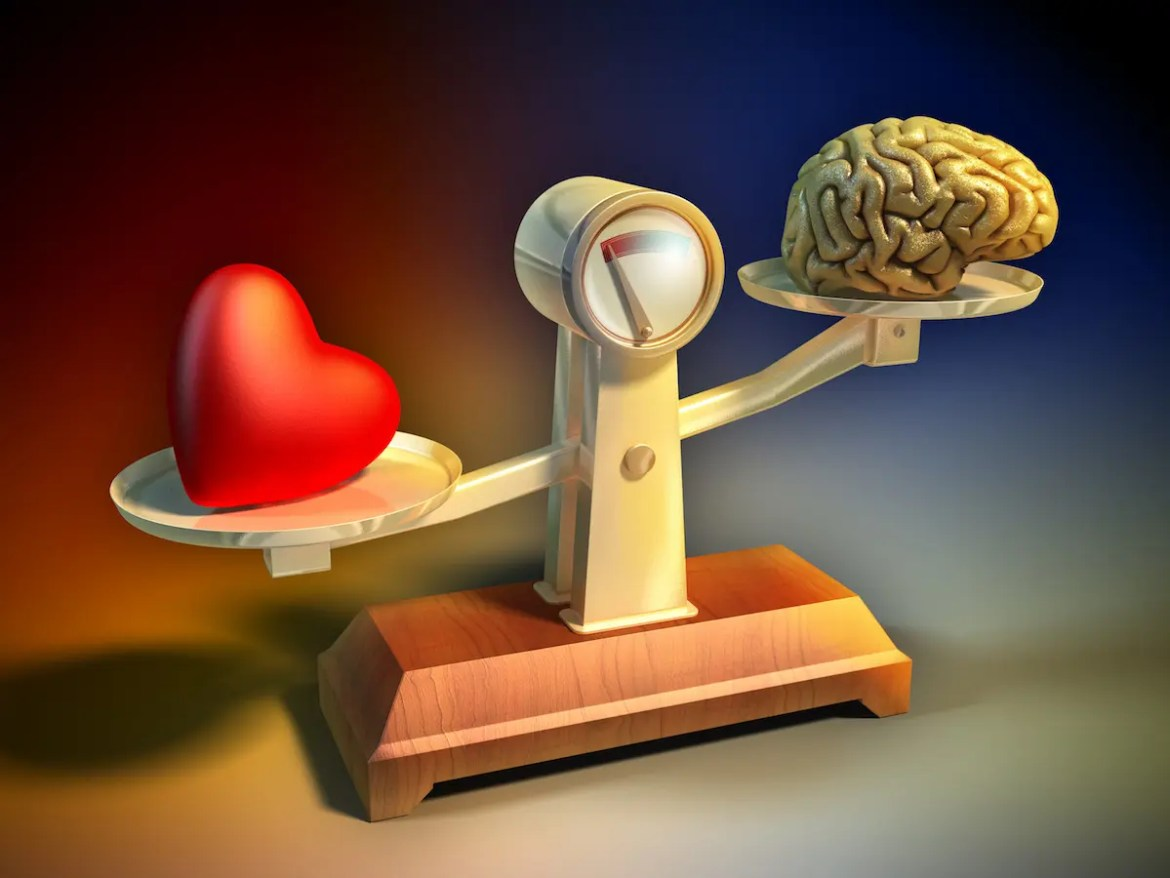 Why following your heart is easier said then done. A picture of a comparative scale with a heart on one side and a brain on the other.