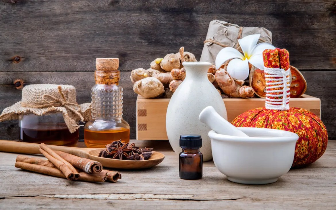 Ayurveda tools and natural herbs and spices are shown. By using natural ingredients, Ayurvedic medicine allows individuals to find balance.