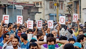Protesters from Kashmir hold signs that read 'Freedom.' The Kashmir Conflict hasn't given justice to the people of the region.