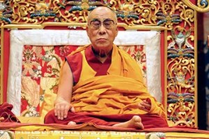 The Dalai Lama is pictured meditating.
