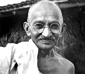 An informal headshot photo of Mahtma Gandhi is shown. Still today, Gandhi quotes are celebrated worldwide.