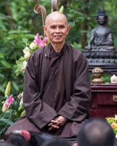 A picture of Zen Buddhist monk Thich Nhat Hanh is shown sitting in a meditation posture.