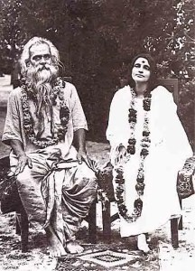 Anandamayi Mi is shown sitting next to her husband.
