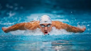 An image is shown of Olympian Hero Michael Phelps swimming in a race.
