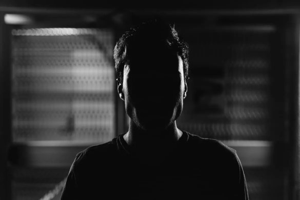An image of a man is shown in a subway station. While you can see the outline of his body, his face is black from a shadow which gives the picture a spooky feel. This image is the featured photo for Balanced Achievement's article about our most profound psychological limitations.