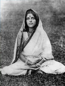 A picture of a young Anandamayi Mi is shown as she sits in a meditative posture.