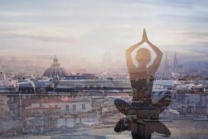 A computer generated image shows a woman sitting in a meditation posture superimposed onto the skyline of a city.