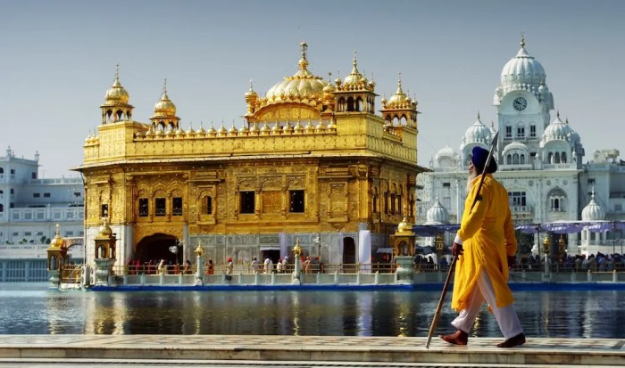 The Golden Temple of Amritsar is shown as a guard patrols in the grounds. Amritsar is one of the numerous sacred cities of India.