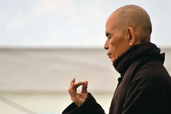 Celebrated Buddhist monk Thich Nhat Hanh is shown meditating with his eyes closed and his hand in a Jnana Mudra seal.