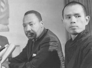 An image shows celebrated Buddhist monk Which That Hanh alongside Martin Luther King Jr.