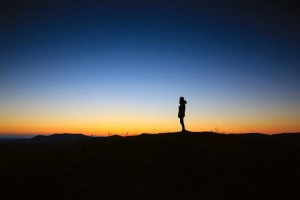 An image shows the silhouette of a man against a morning sunrise. This image represents the idea that each time the sun rises we can focus on making today memorable.