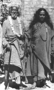 An image from 1935 shows Paramahansa Yogananda and his guru, Swami Yukteswar, standing side by side.