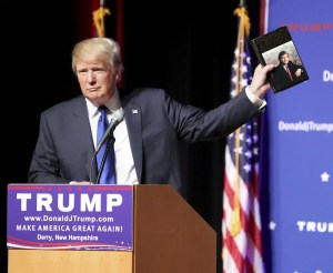 An image shows Donald Trump campaigning for the 2016 Presidency while holding his book 'The Art of the Deal'.