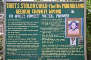 A sign in Dharamsala, India, shows a picture of the 11th Panchen Lama and gives details about his disappearance. His story shows why the Tibet China conflict is in such a precarious place.