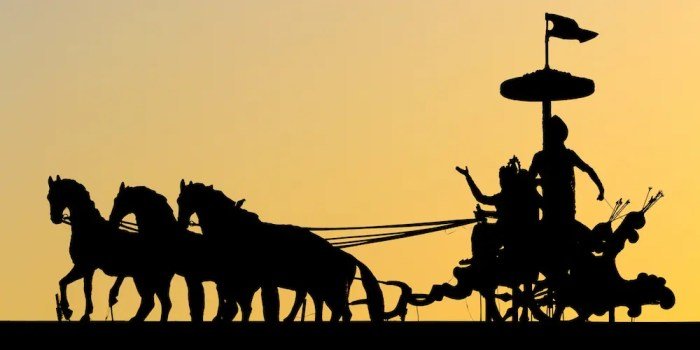 An image shows a silhouette aiming to represent the famous Hindu story of the Bagahvad-Gita with Krishna and Arjuna on their chariot. The concepts of Karma and Dharma are talked about extensively in this epic.