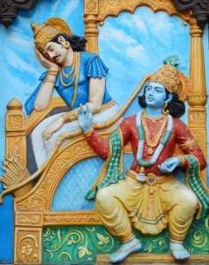 A picture shows wall art of Krishna and Arjuna from the classic Hindu epic the Bhagavad Gita. This image is featured in Balanced Achievement's article on karma and dharma.
