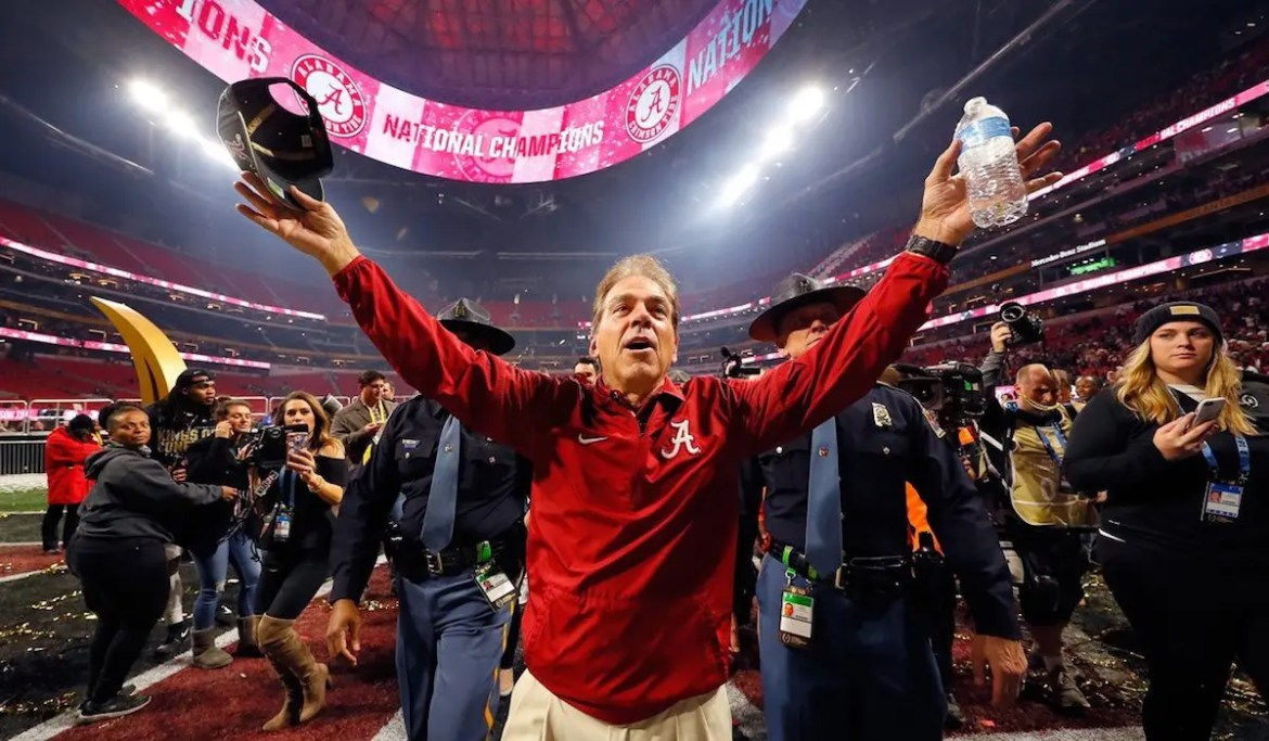 An image shows University of Alabama Football coach with his hands in the air as he celebrated winning the National Championship on January 8th, 2018. This picture serves as the featured image for Balanced Achievement's article on Nick Saban's process. (Photo: Kevin C. Cox/Getty Images)