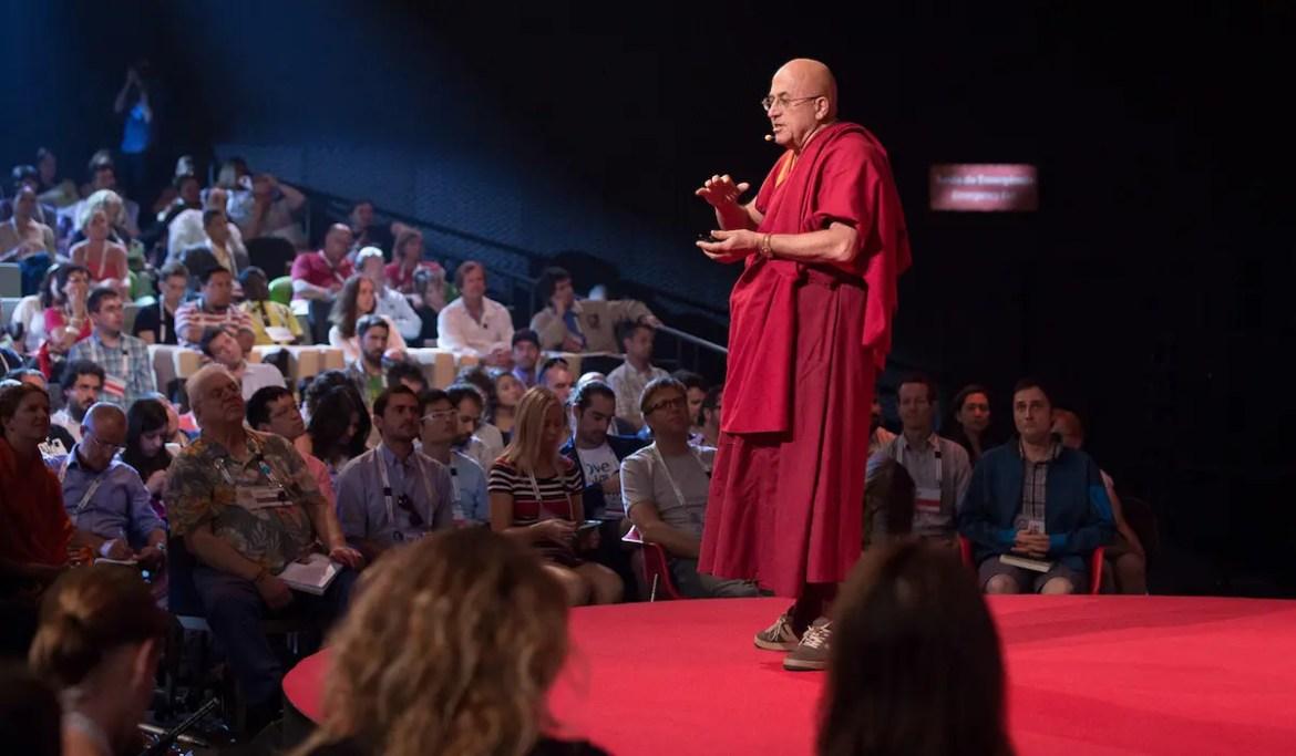 An image shows the celebrated Buddhist monk Matthieu Ricard on stage while delivering a Ted Talk. This picture serves as the featured image for Balanced Achievement's article the most enlightening TED Talks on mindfulness and meditation.