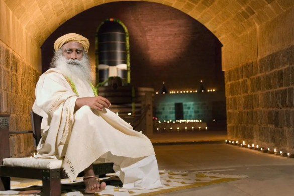 An image shows the great Hindu mystic Jaggi Vasudev, also commonly known as Sadhguru, sitting in the Dhyanalinga temple complex which he constructed in 1999.