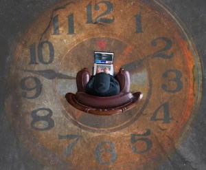 An image shows an overhead picture of a man sitting in a chair that's placed in the center of a clock painted on the floor. This image represents the idea that we can strive to become more and still achieve life's ultimate aim of finding enjoyment in the days by keeping understanding the reality of our situation.