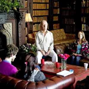 An image shows Colin Beckley, Founder & Director of The Meditation Trust, as he practices meditation with a group students. His advice is featured in Part I of Balanced Achievement's article '6 Spiritual Teachers on America's Divisive Political Climate'.