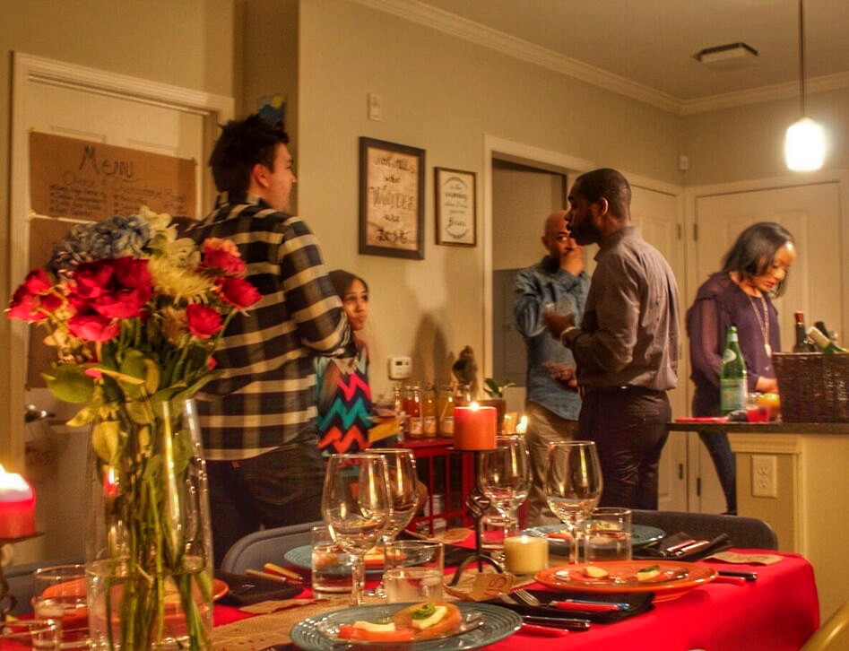 Guests getting to know each other before the February dinner. Photo Credit: Kayla Parchia