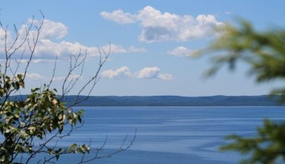 Glen Lake blue sky clouds and hilly horizon_Glen Arbor_Leelanau Peninsula