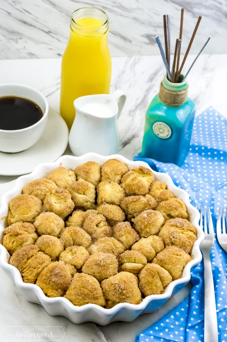 Baked donut holes with orange juice and coffee