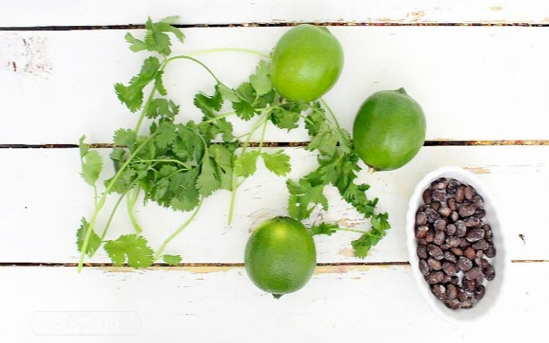 limes, cilantro, and black beans on board